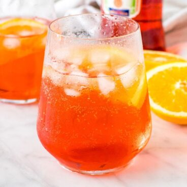 A glass of aperol spritz with ice