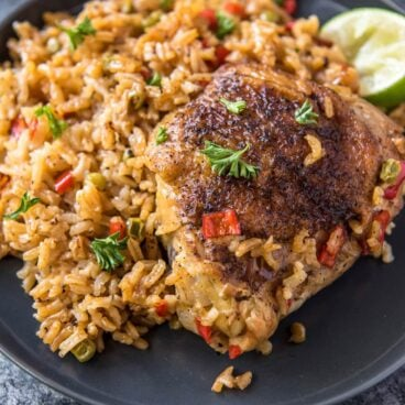 A plate of Spanish rice and chicken.