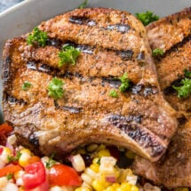 Grilled pork chops with side of corn salad