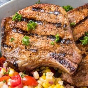 Grilled pork chops with side of corn salad