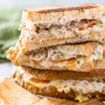 A grilled tuna sandwich with cheese, cut in half