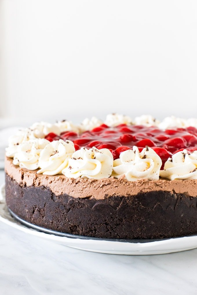 Entire black forest cheesecake topped with cherry pie filling.