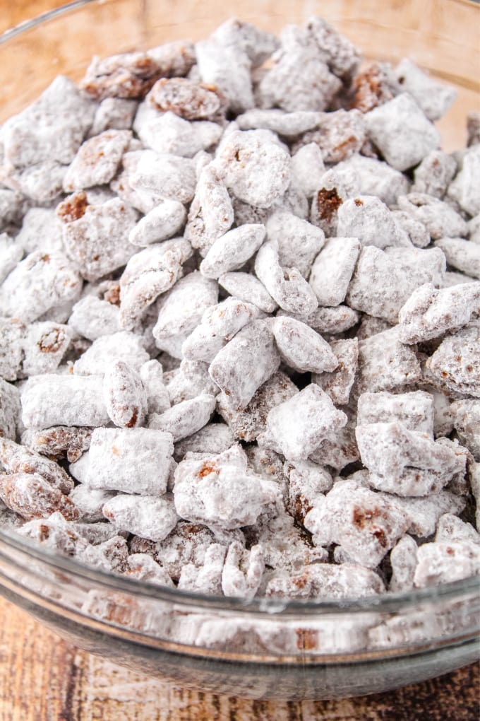 muddy buddies in a glass bowl after shaking