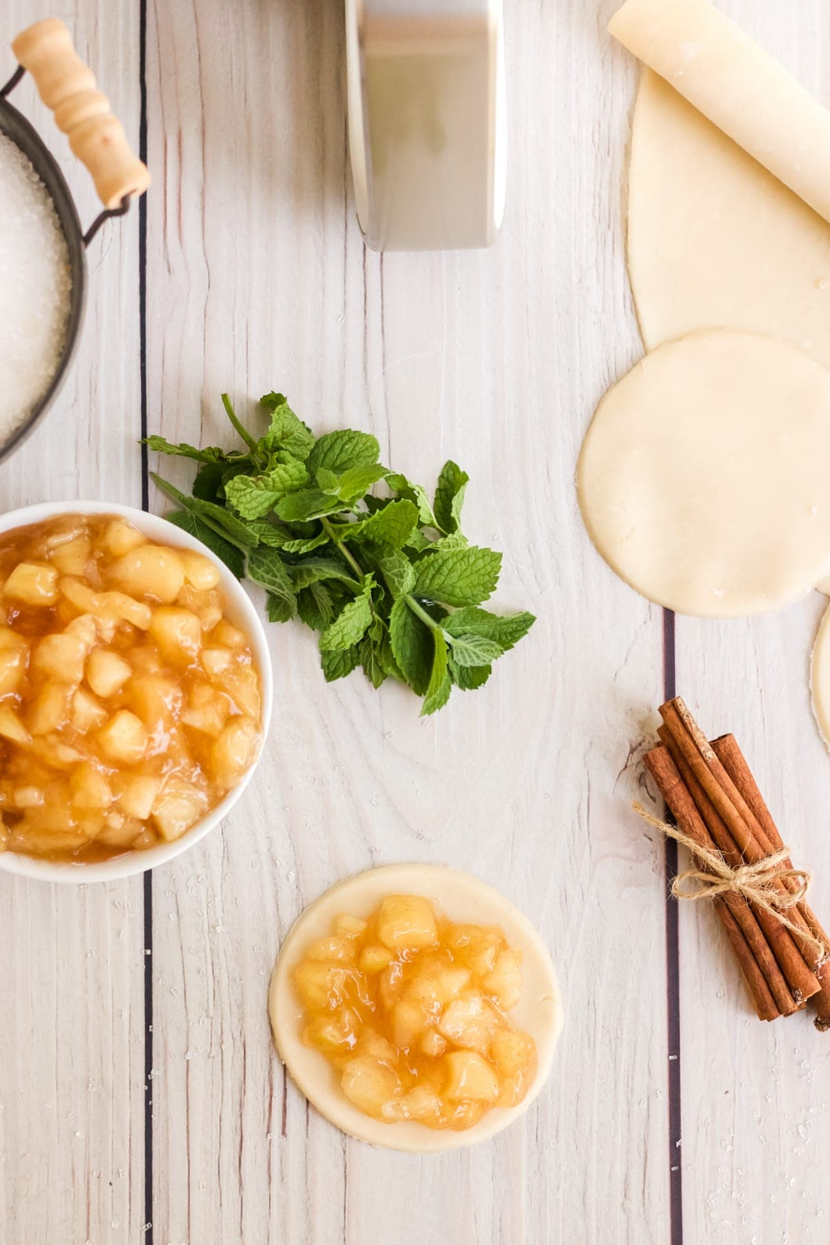 bowl of apple pie filling and pie crusts