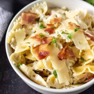 bowtie pasta, cream sauce bacon, white bowl
