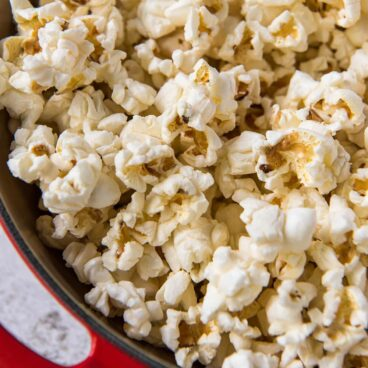 Popcorn in a red pot.
