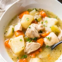 chicken stew in a white bowl on a table