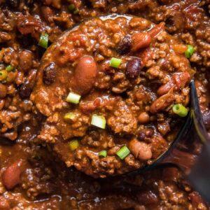 beef chili, ladle, green onions