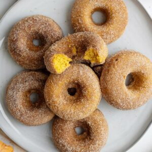 pumpkin donuts on a white platter