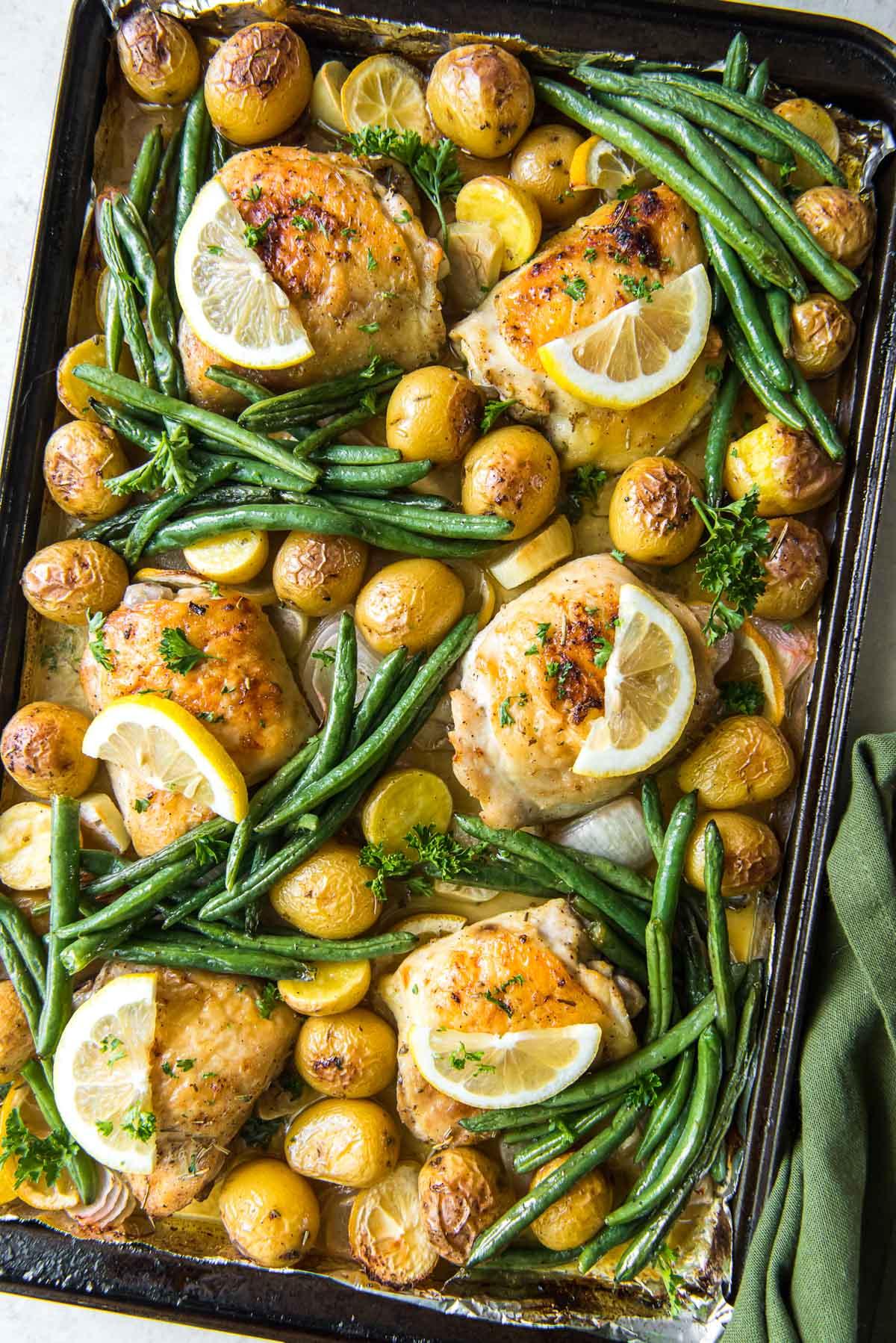 large sheet pan chicken, potatoes, green beans, lemons, garlic, onions