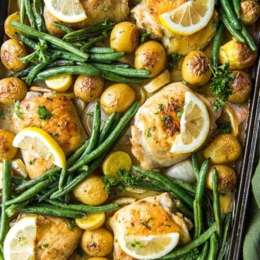 sheet pan chicken thighs, potatoes, green beans and lemons