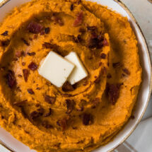 mashed sweet potatoes with bacon and 2 pats of butter
