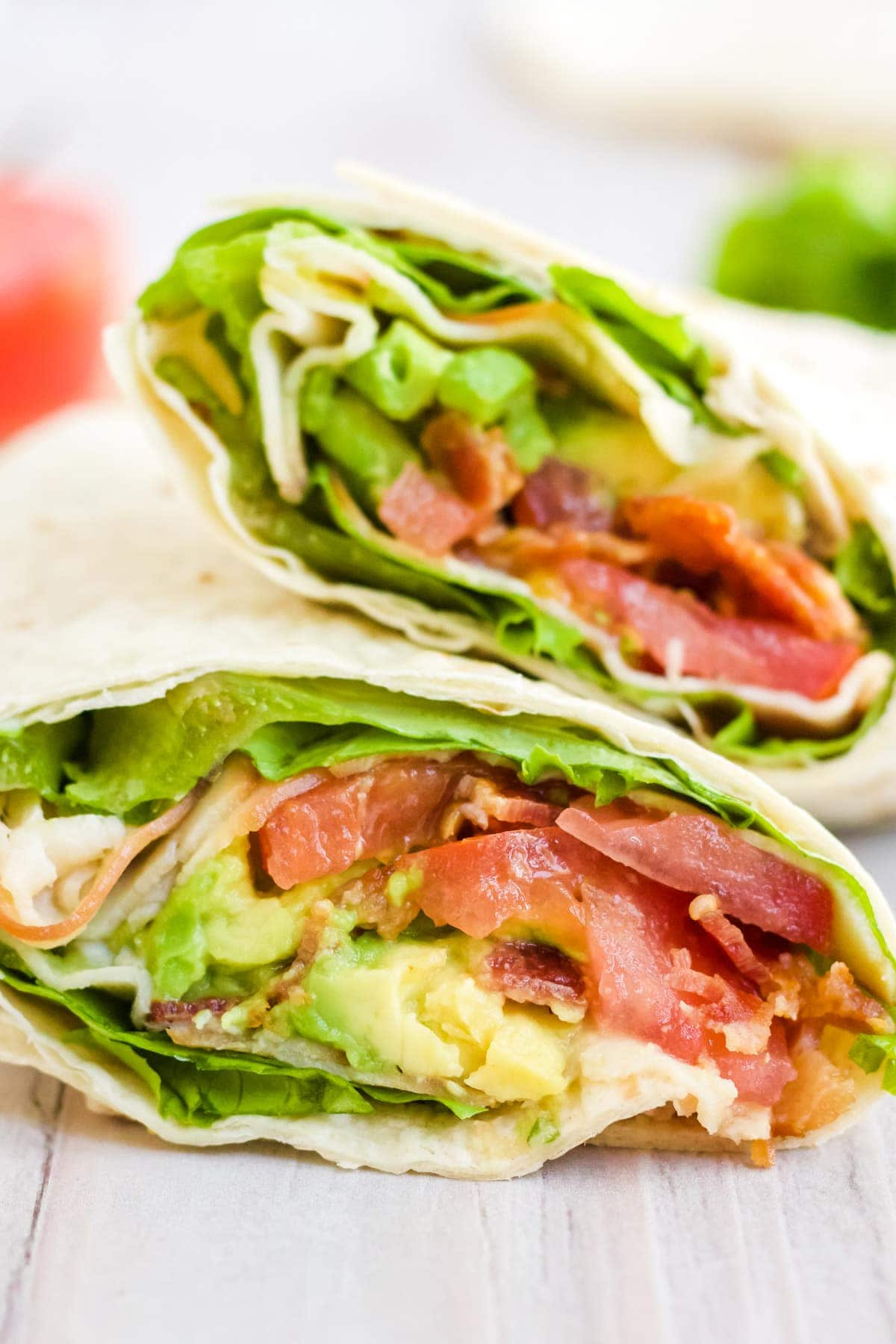 A close up image of a finished turkey BLT wrap