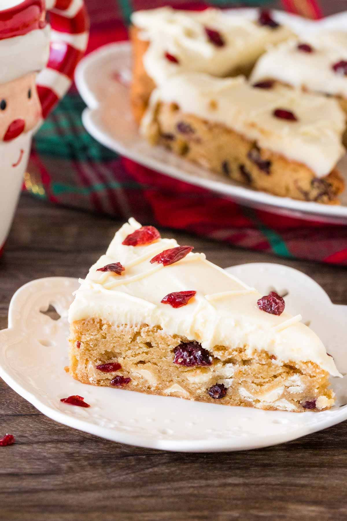 Slice of cranberry bar with cream cheese frosting