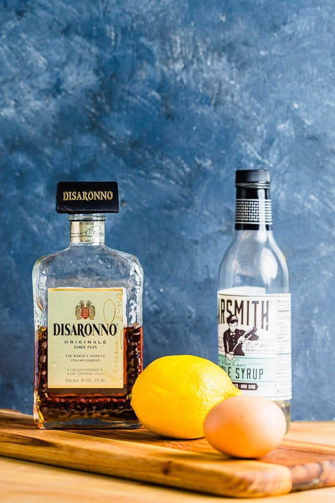Ingredients shown: Amaretto, simple syrup, lemon, and egg.