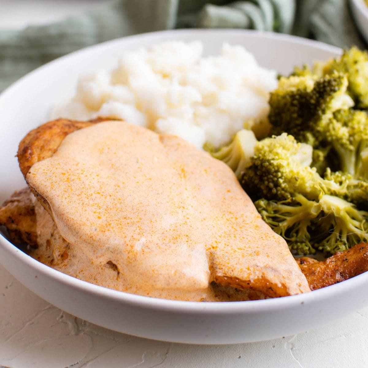 chicken breasts, mustard sauce, broccoli, mashed potatoed