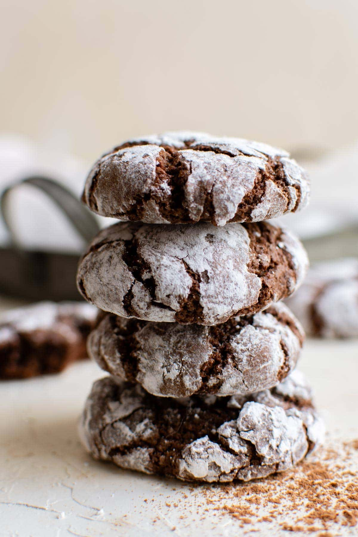 stack of chocolate cookies with powdered sugar