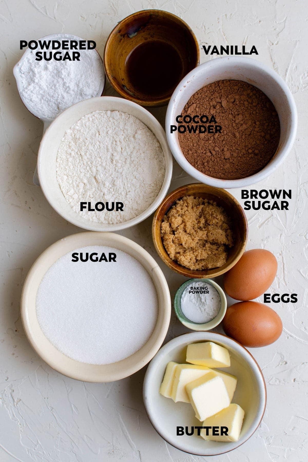 ingredients in bowls for making chocolate crinkle cookies