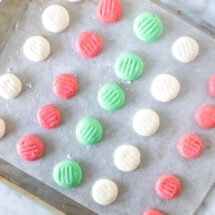 Cookie sheet of cream cheese candies.