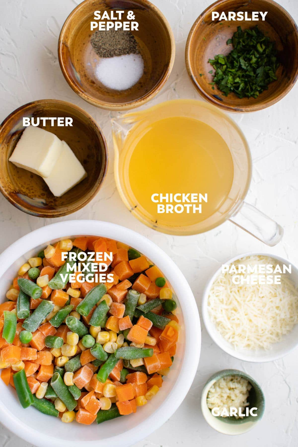 frozen mixed vegetables, butter, chicken broth, parsley, garlicm parmesan cheese, brown dishes, white dishes