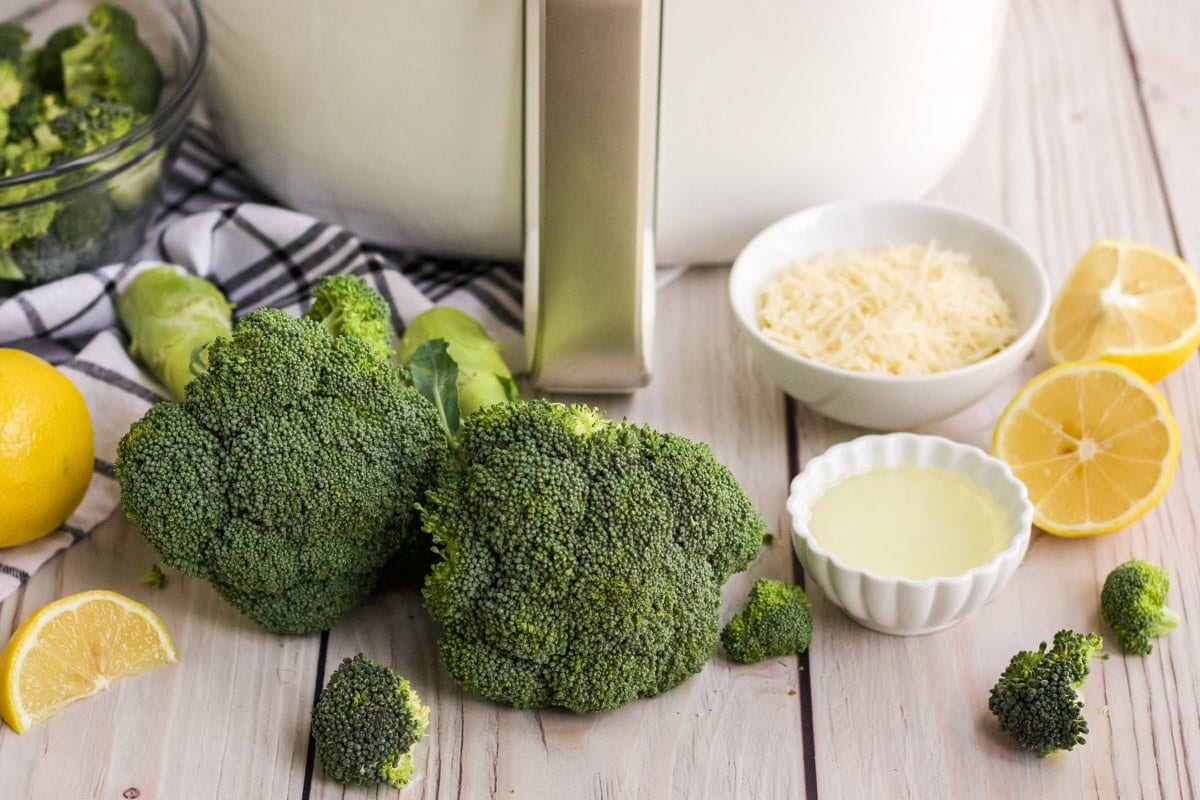 broccoli, air fryer, parmesan cheese, lemons, olive oil, blue and white napkin