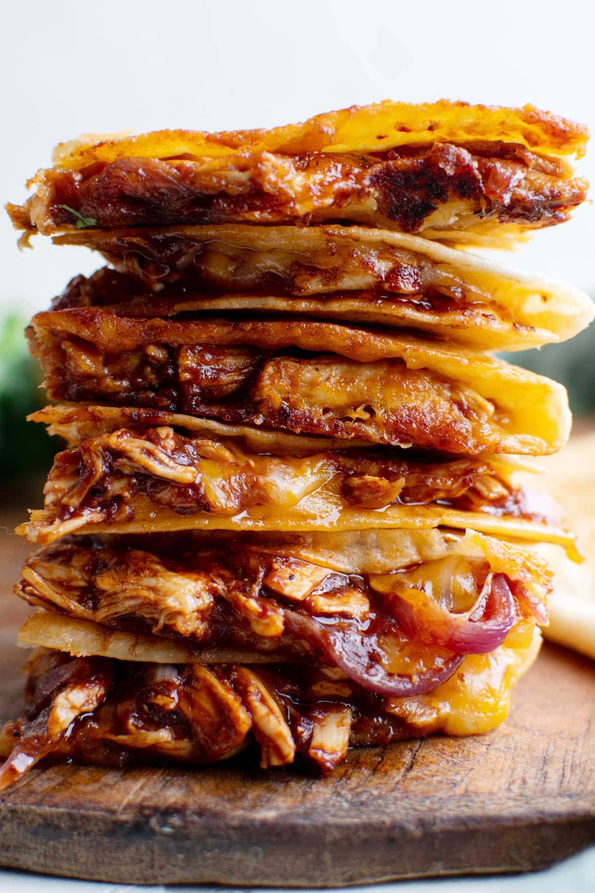 stack of chicken quesadillas on wood cutting board