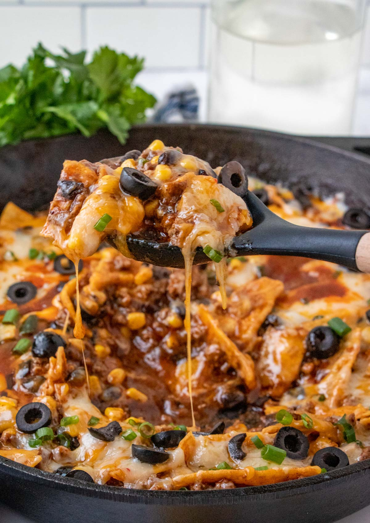 enchilada skillet, cast iron skillet, olives, black spoon