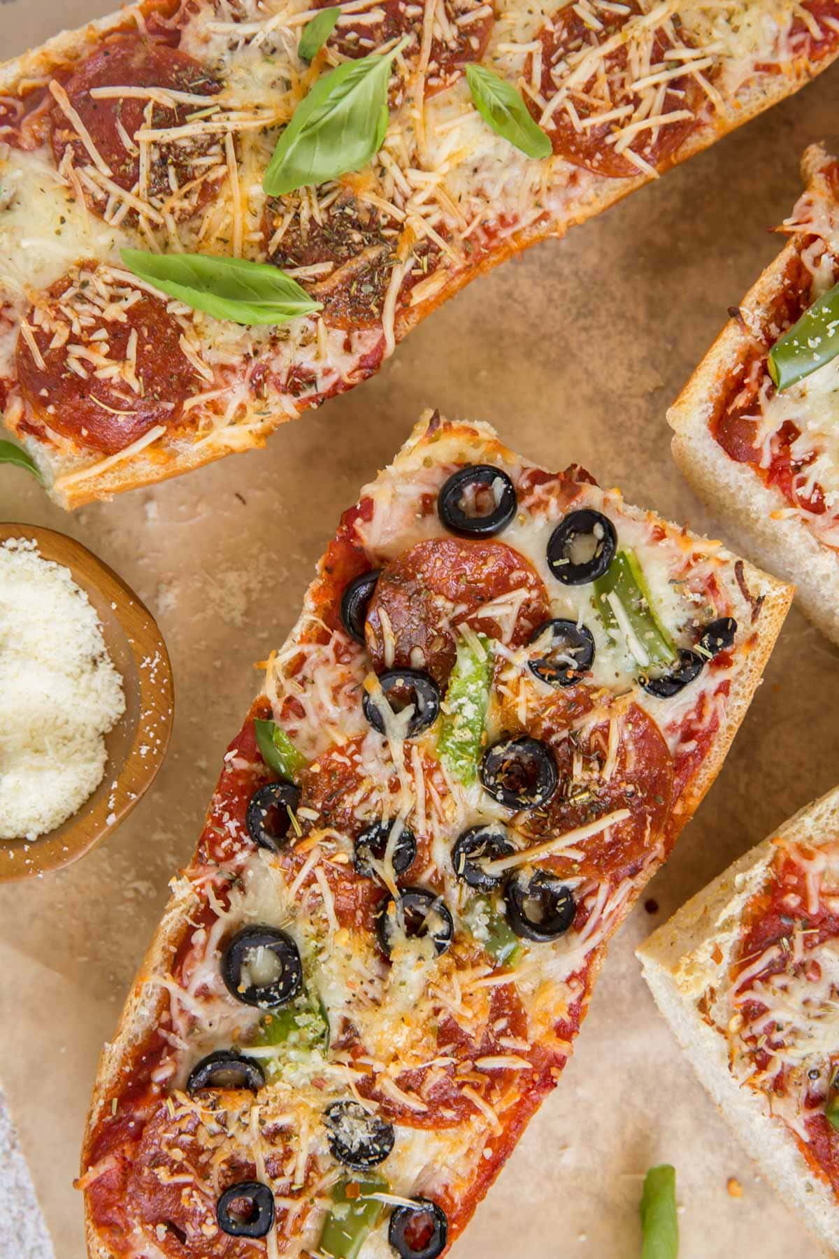 pizza bread with olives and cheese, brown parchment paper