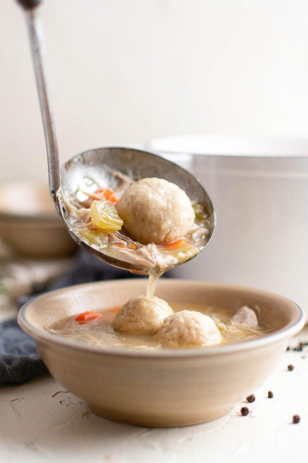 ladle, soup, matzo balls, white bowl