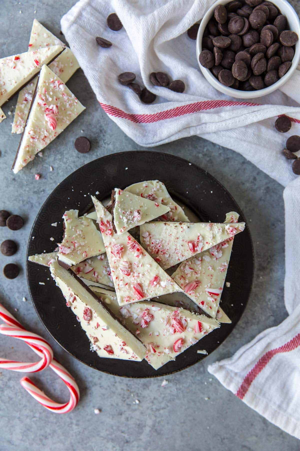 peppermint bark, candy canes, black plate, white towel, chocolate chipe