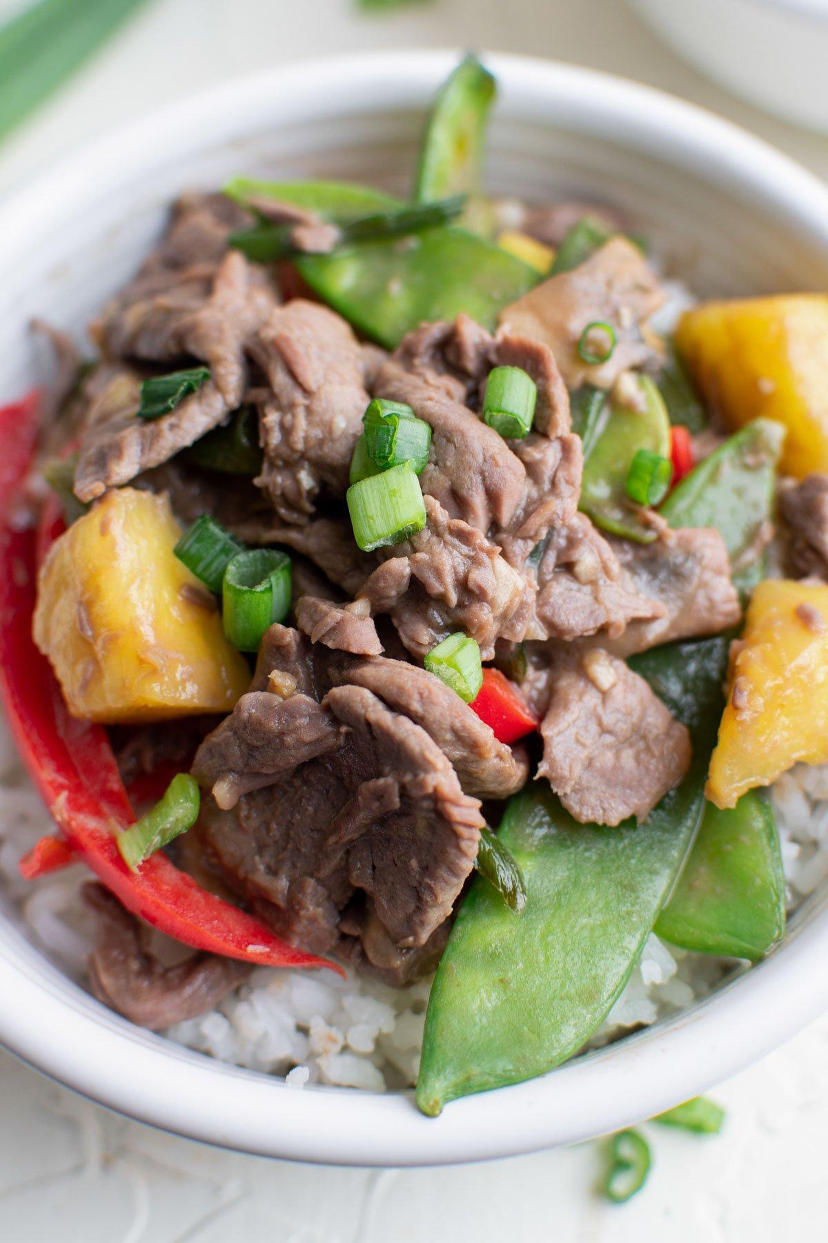 white bowl, stir fry vegetables, pineapple, beef