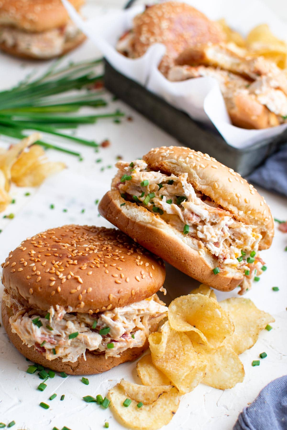 sesame seed buns, creamy bacon ranch chicken, potato chips, chives