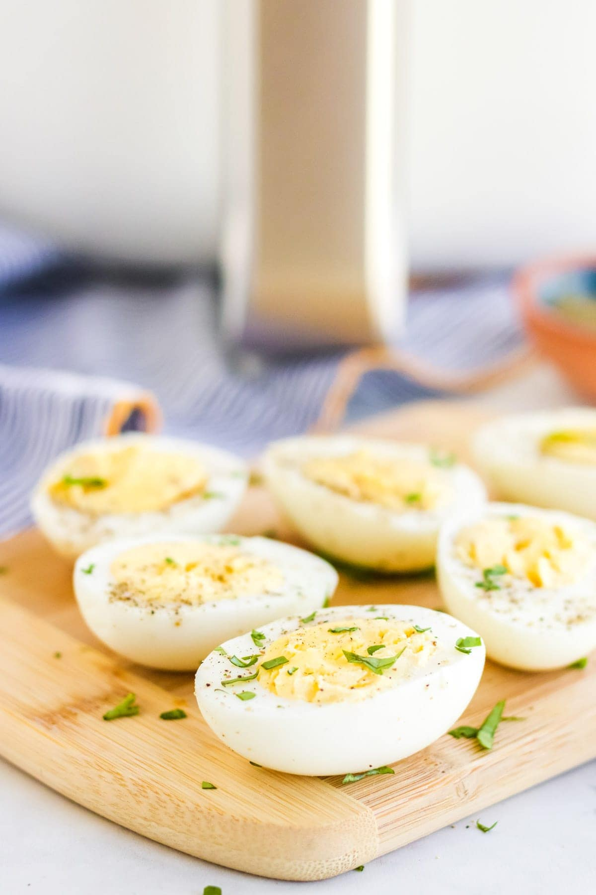 Hard boiled eggs, ut in half, with parsley and black pepper, air fryer