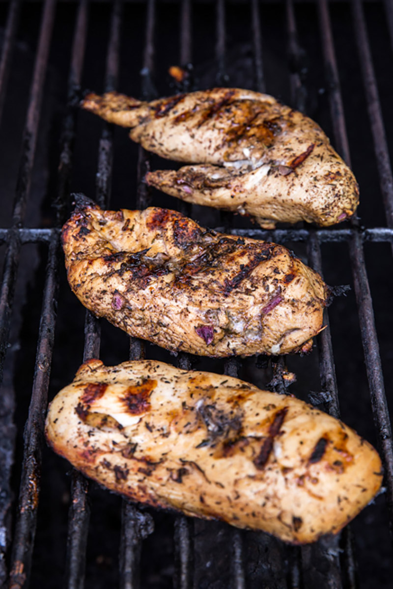 chicken breasts on a grill with grill marks