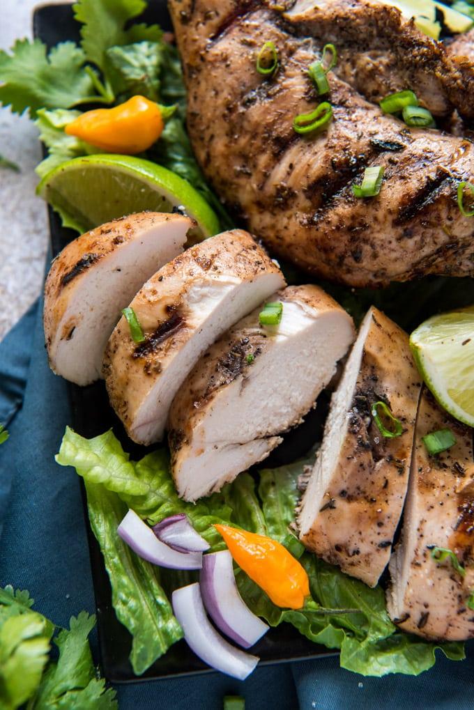 sliced jerk chiken on lettuce