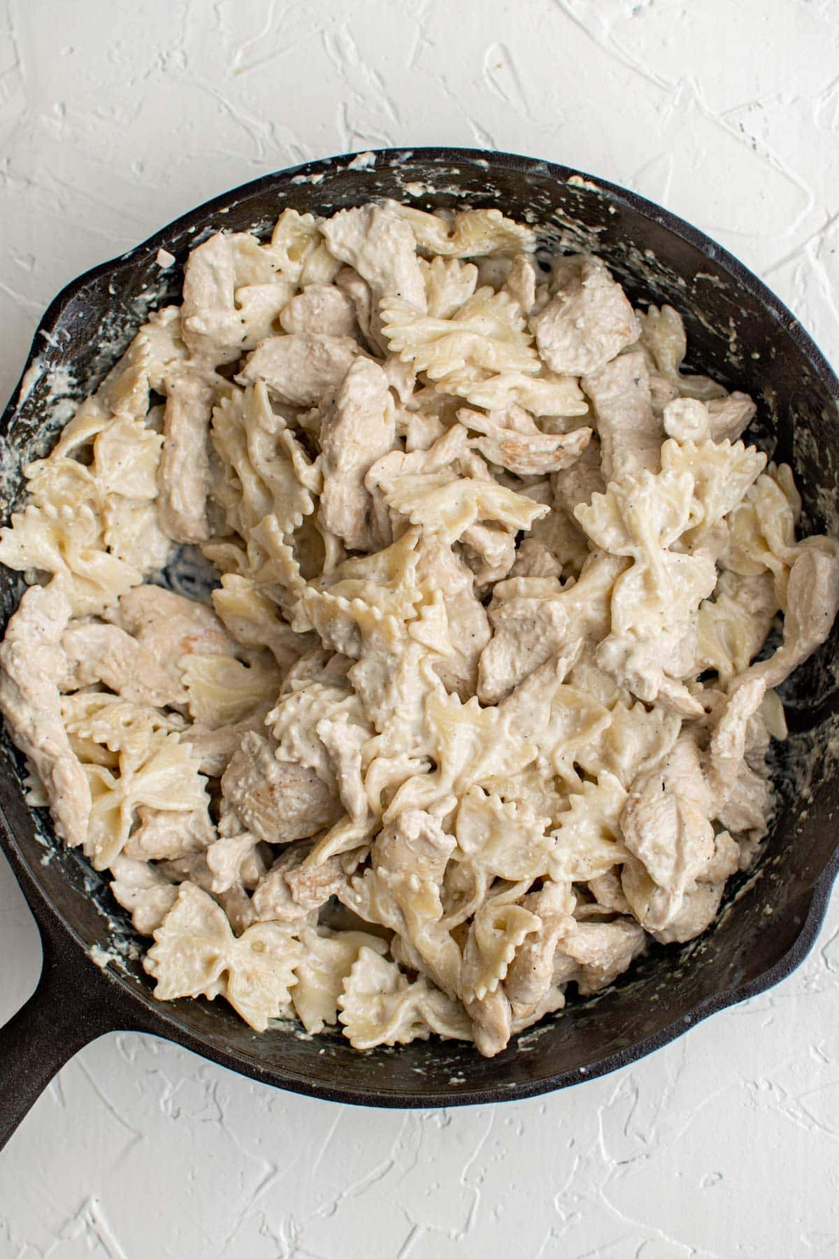 chicken and pasta in creamy sauce, cast iron skillet