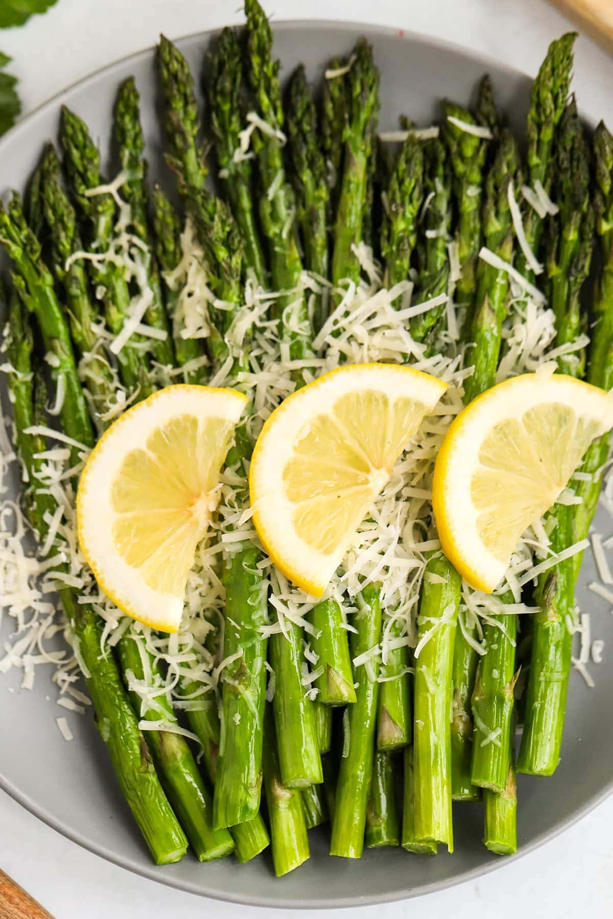 plated asparagus with lemon and parmesan