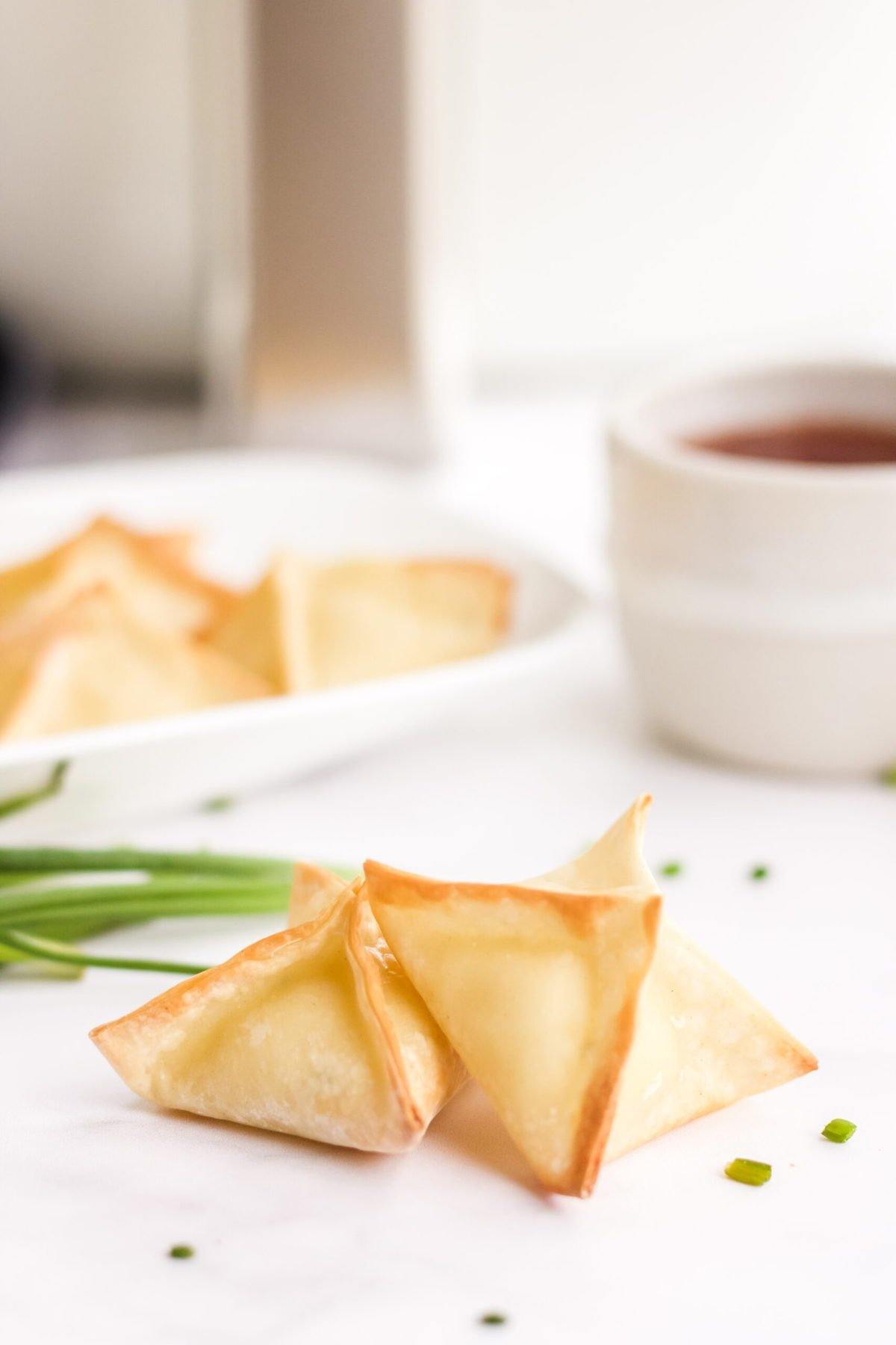 air fryer wontons with cream cheese filling, air fryer, dipping sauce.