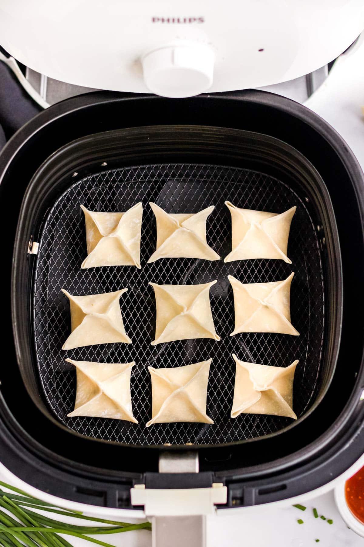 uncooked wontons in air fryer basket