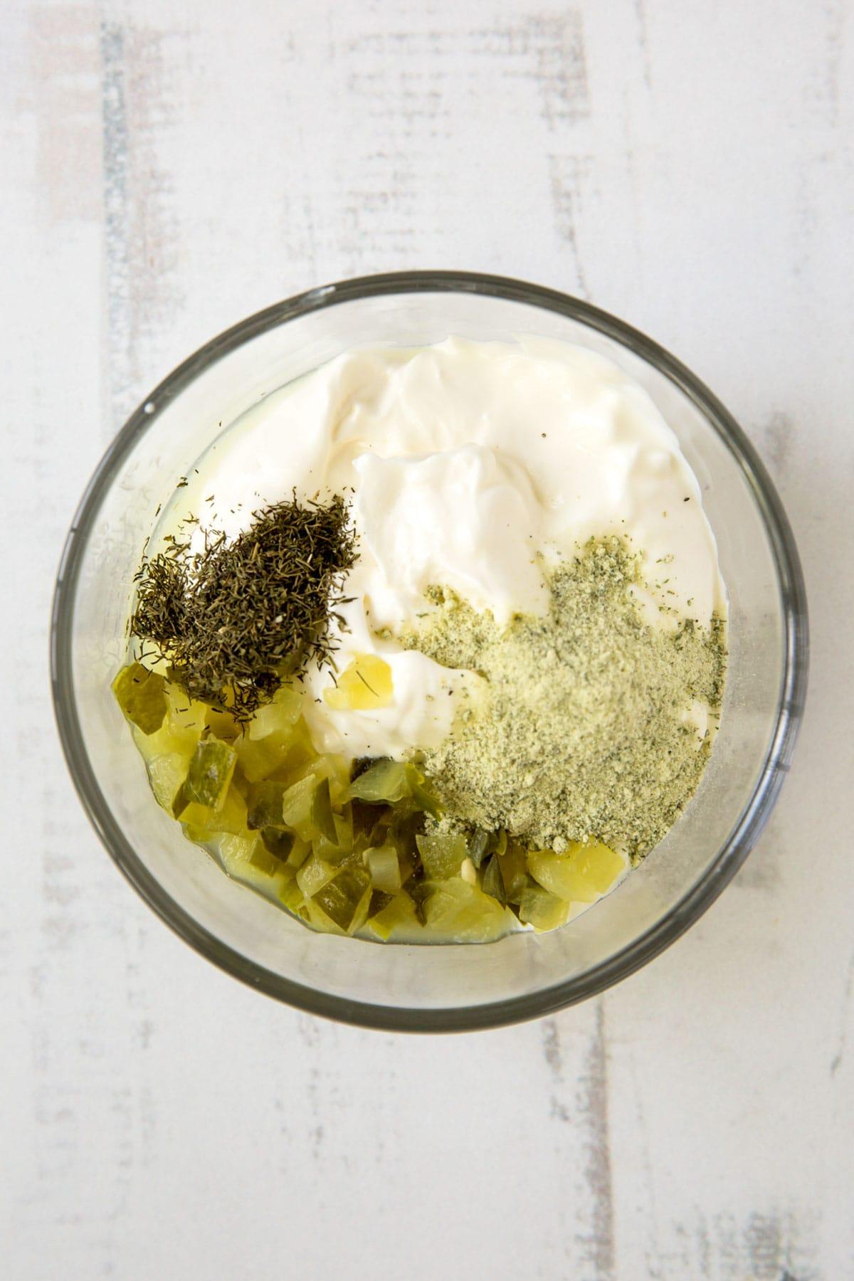 pickles, greek yogurt, dill in a bowl