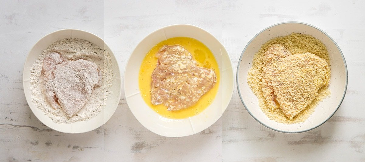 bowls with flour, eggs and breading for fried chicken