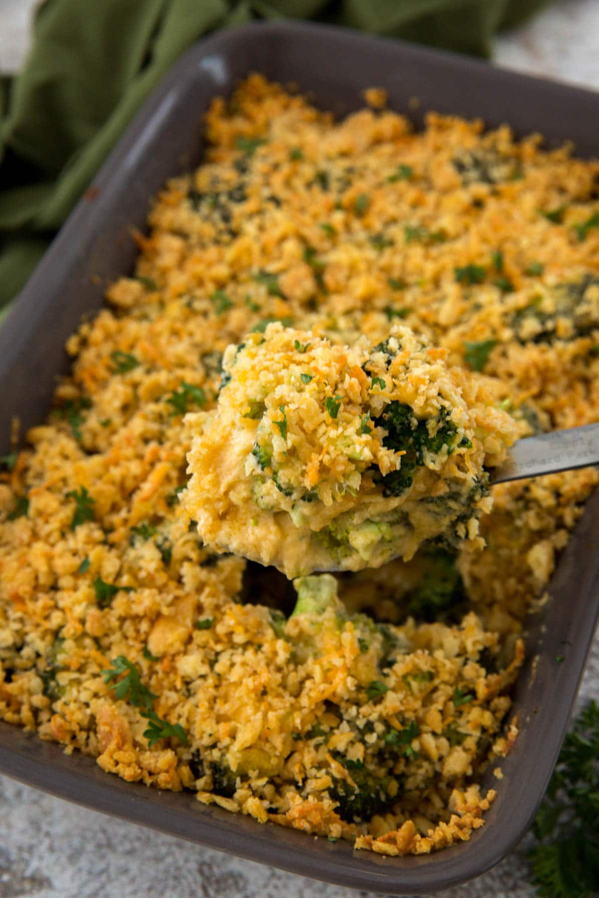 gray baking dish, broccoli casserole, serving spoon