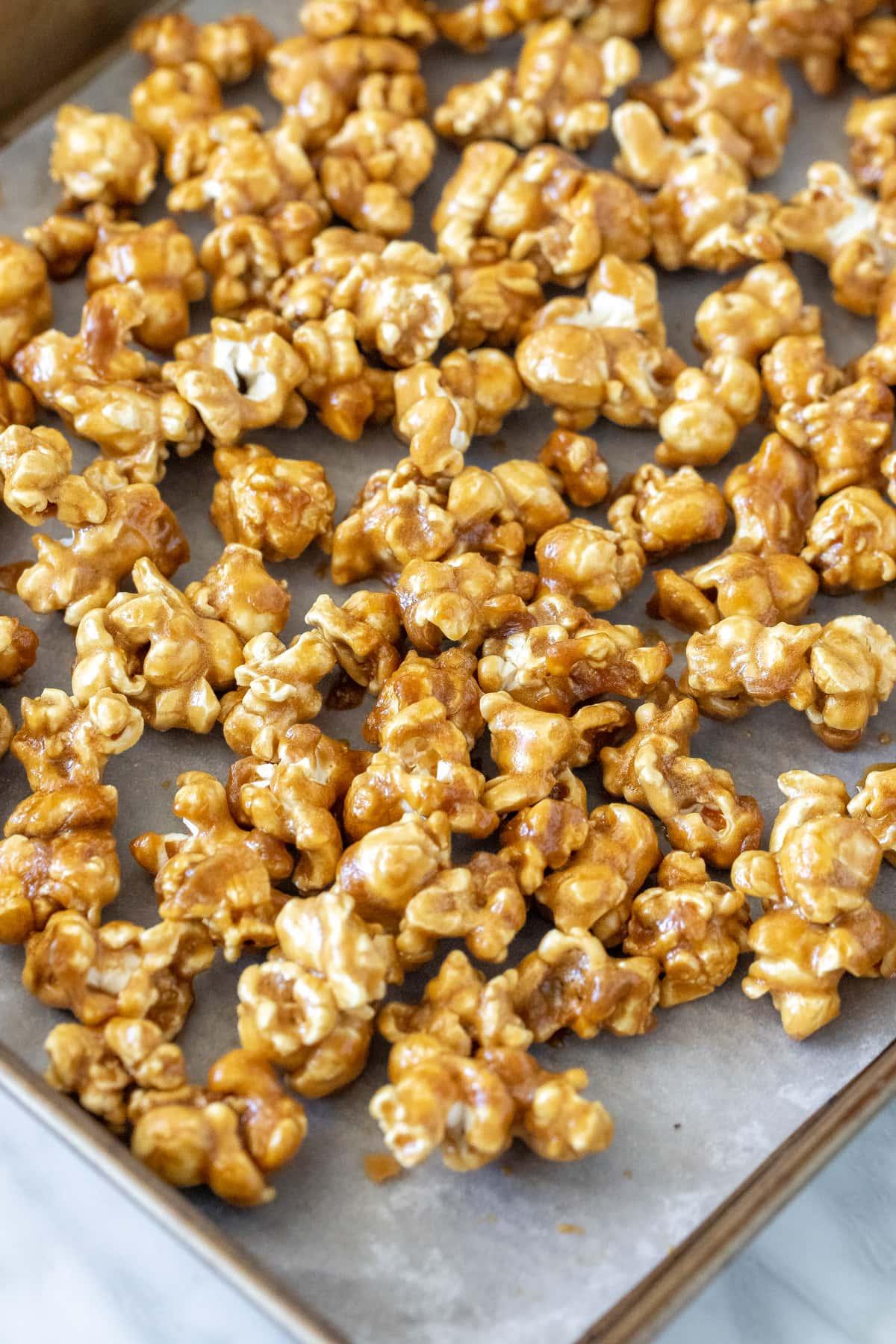 Caramel popcorn on a baking sheet