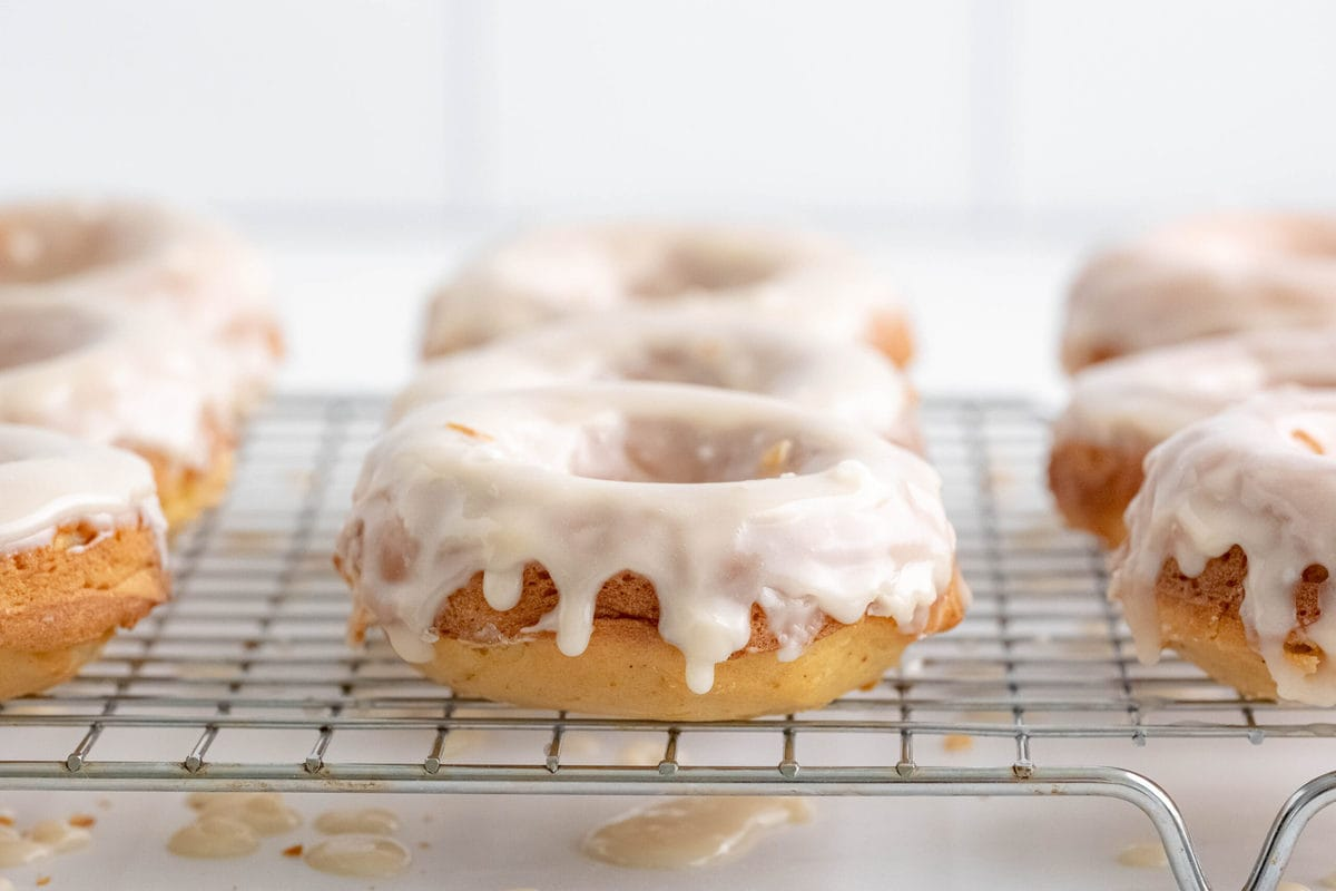 baked glazed donuts on a wire rack