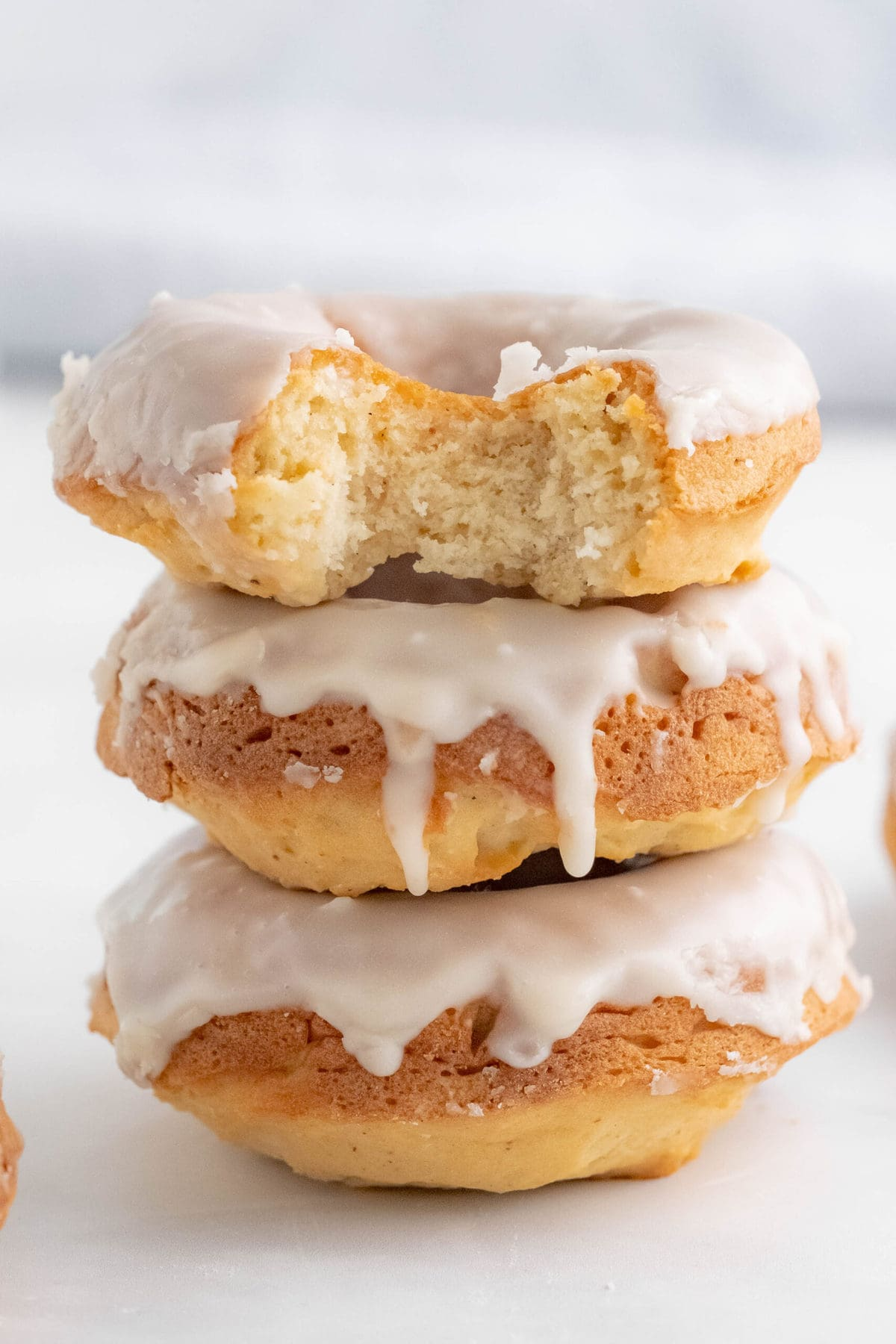 stack of donuts with a bite taken out of one