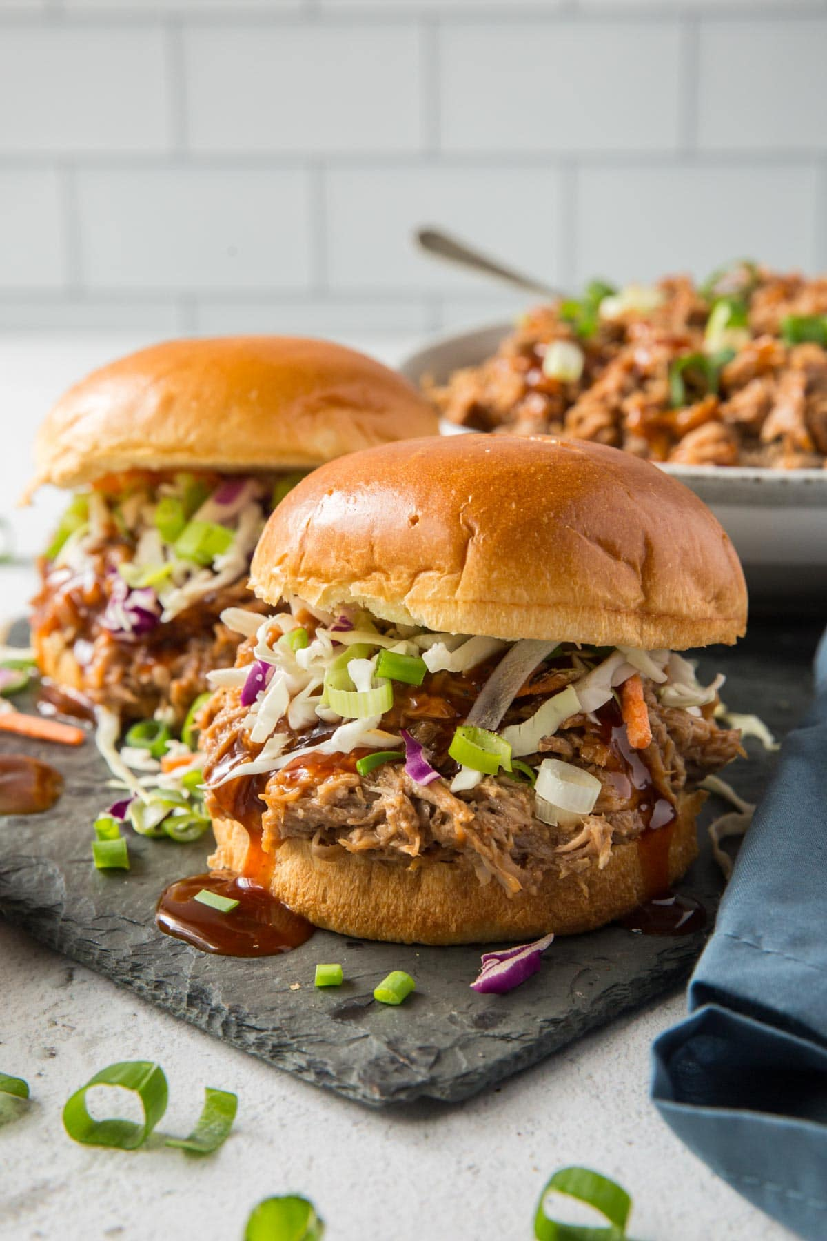 bbq pulled pork sandwiches on a slate board