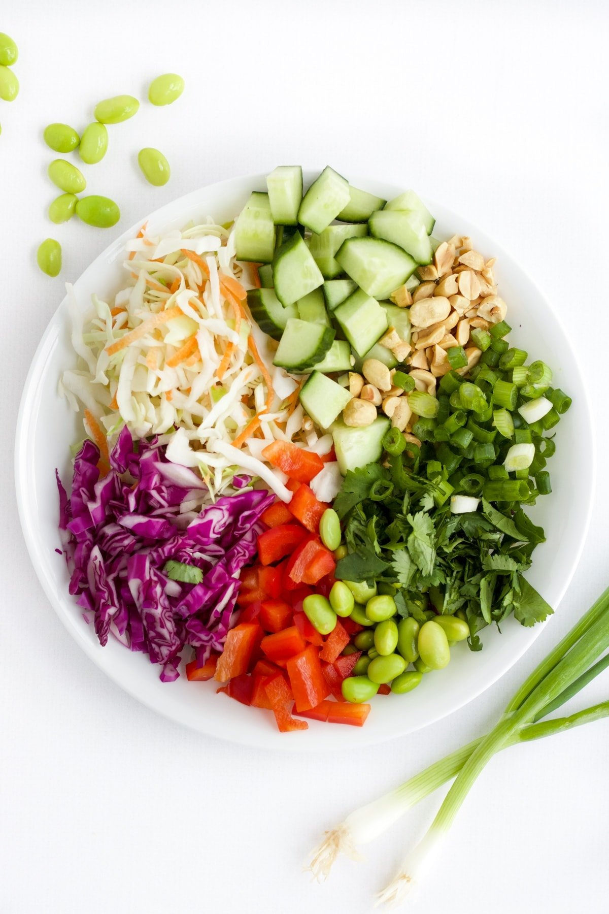 Ingredients for Thai Salad in a white bowl.