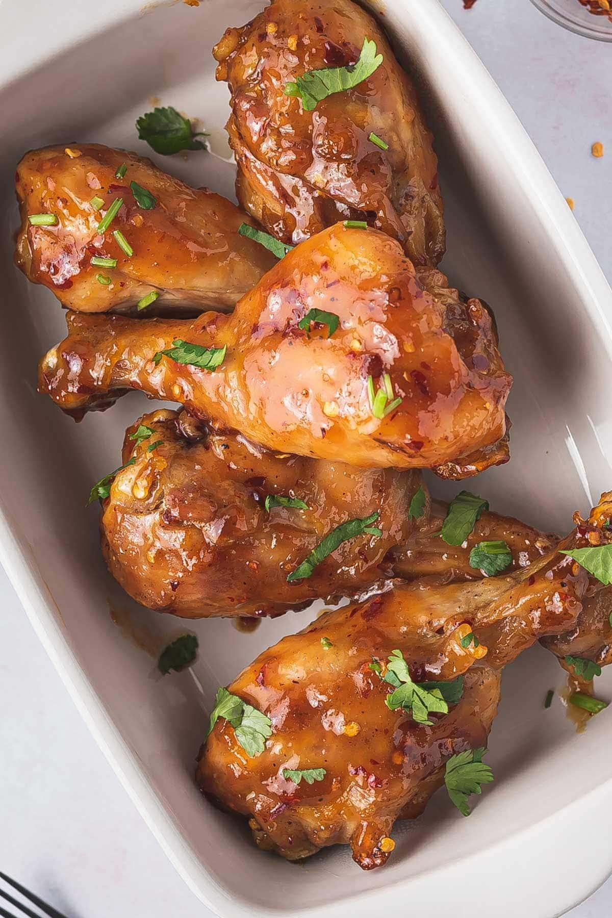 air fryer Chicken Drumsticks served on a white pan