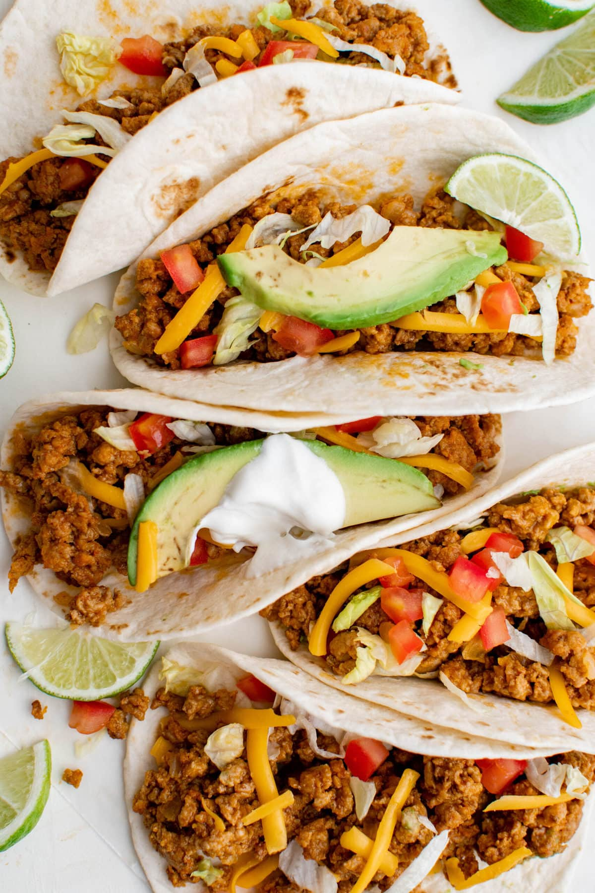 flour tortillas stuffed with ground turkey, cheese, lettuce, tomatoes, limes