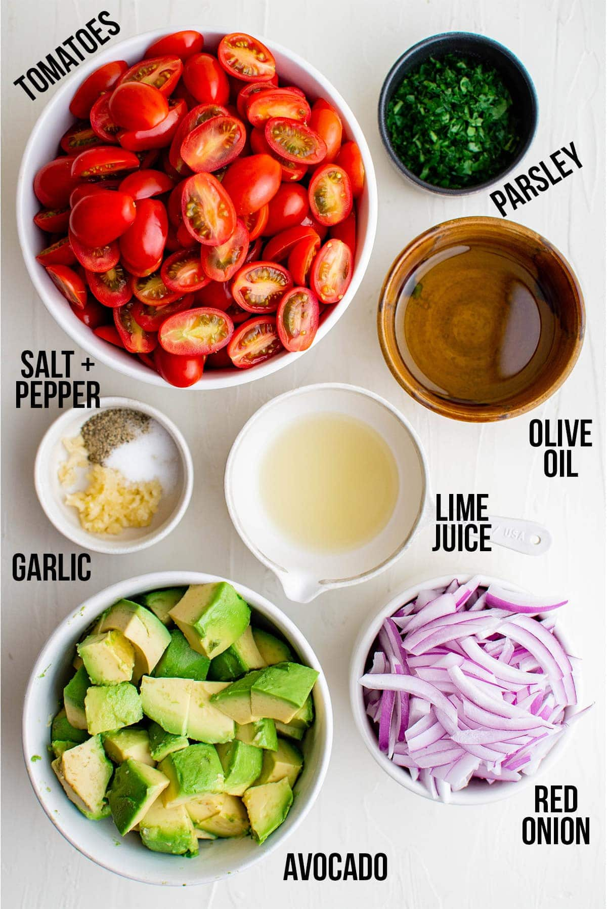 Ingredients for tomato and avocado salad